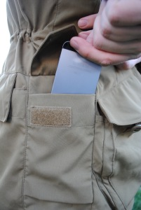 Side pocket between the front and rear, big enough to hold a magazine-sized item