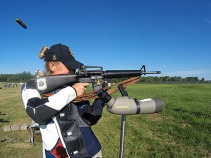 CAMP PERRY, Ohio (July 22, 2015) - Spc. Larissa Robertson fires the standing portion of the President's 100 Trophy Match July 22 during the Rifle Nationals at Camp Perry, Ohio, July 22.